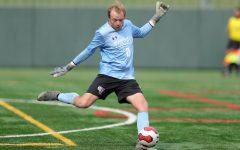 A Billikens soccer play kicks a ball