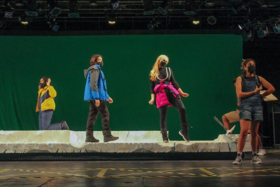 Actors on a stage for a production of Continuity