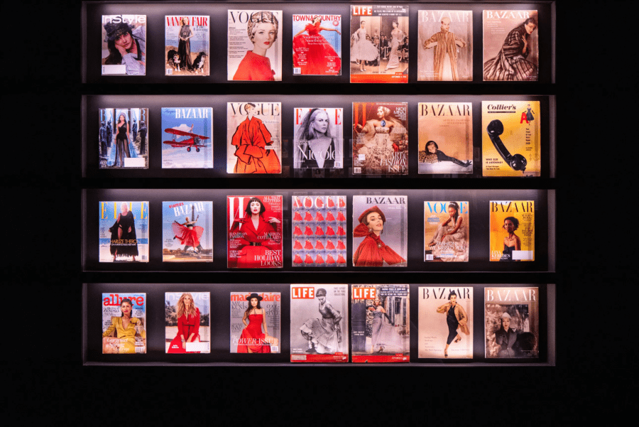 A wall of red, pink and yellow photographs