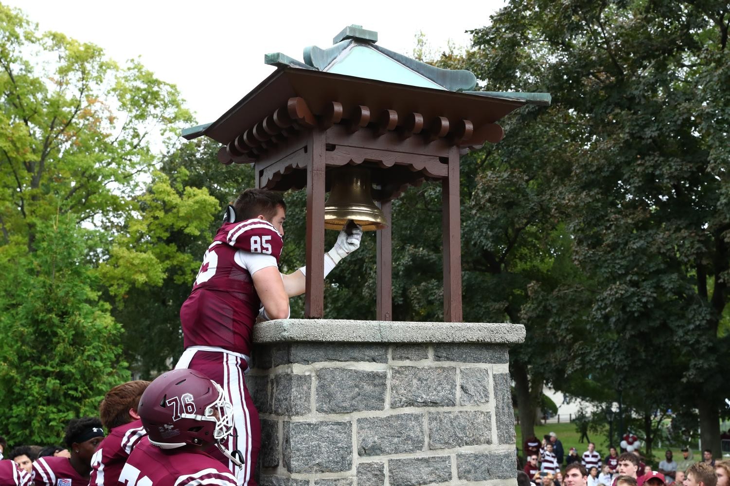 peter fitzgerald rings the victory bell at wagner game for homecoming