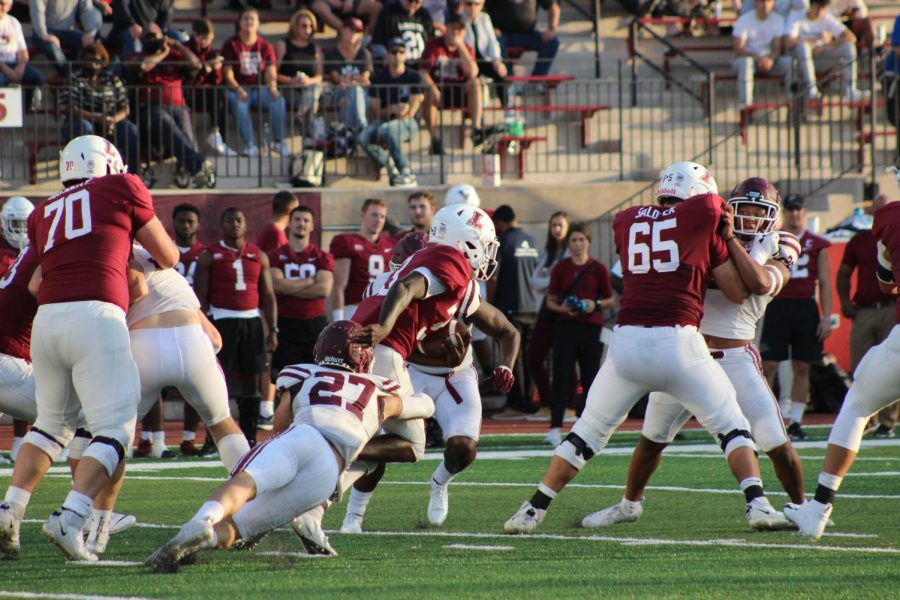 a Fordham football player tackling a Lafayette football player
