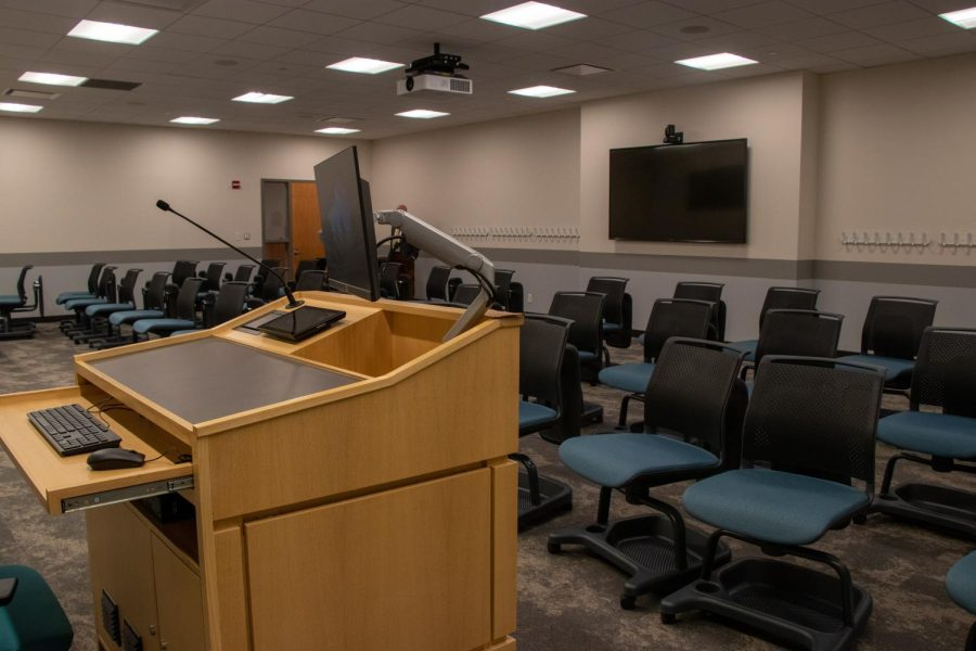 new lowenstein classrooms with projector and tv screens as well as usual desk chairs