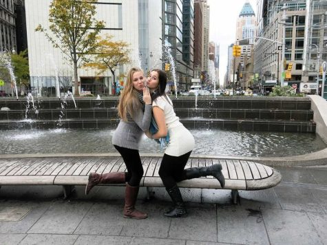 anne-sophie neumeister takes a picture at columbus circle with rachel menze