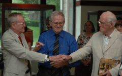 a photo of the McCabe brothers shaking hands, John, Francis, and James