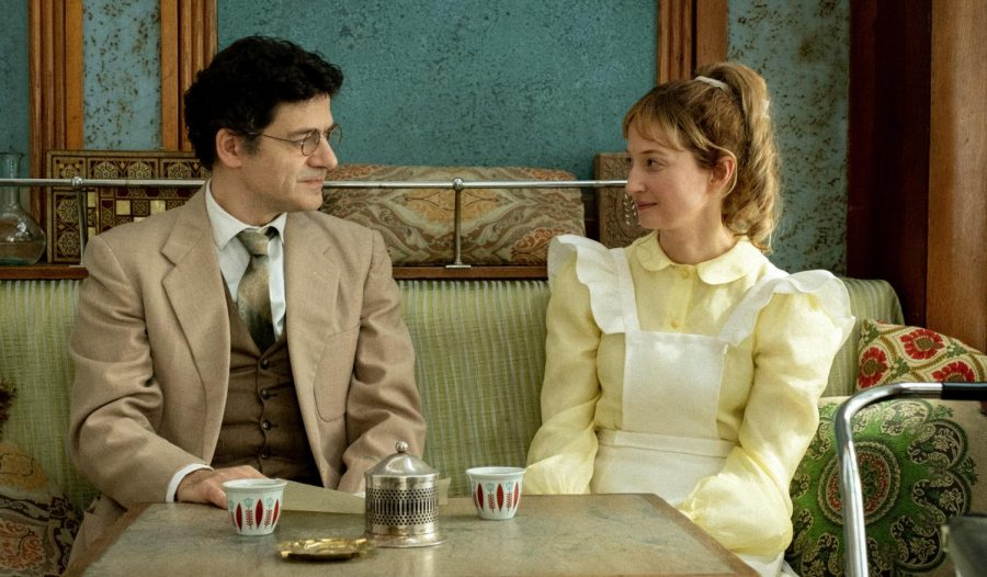 at the french film festival, two characters from skies of lebanon sit on a couch in period dress